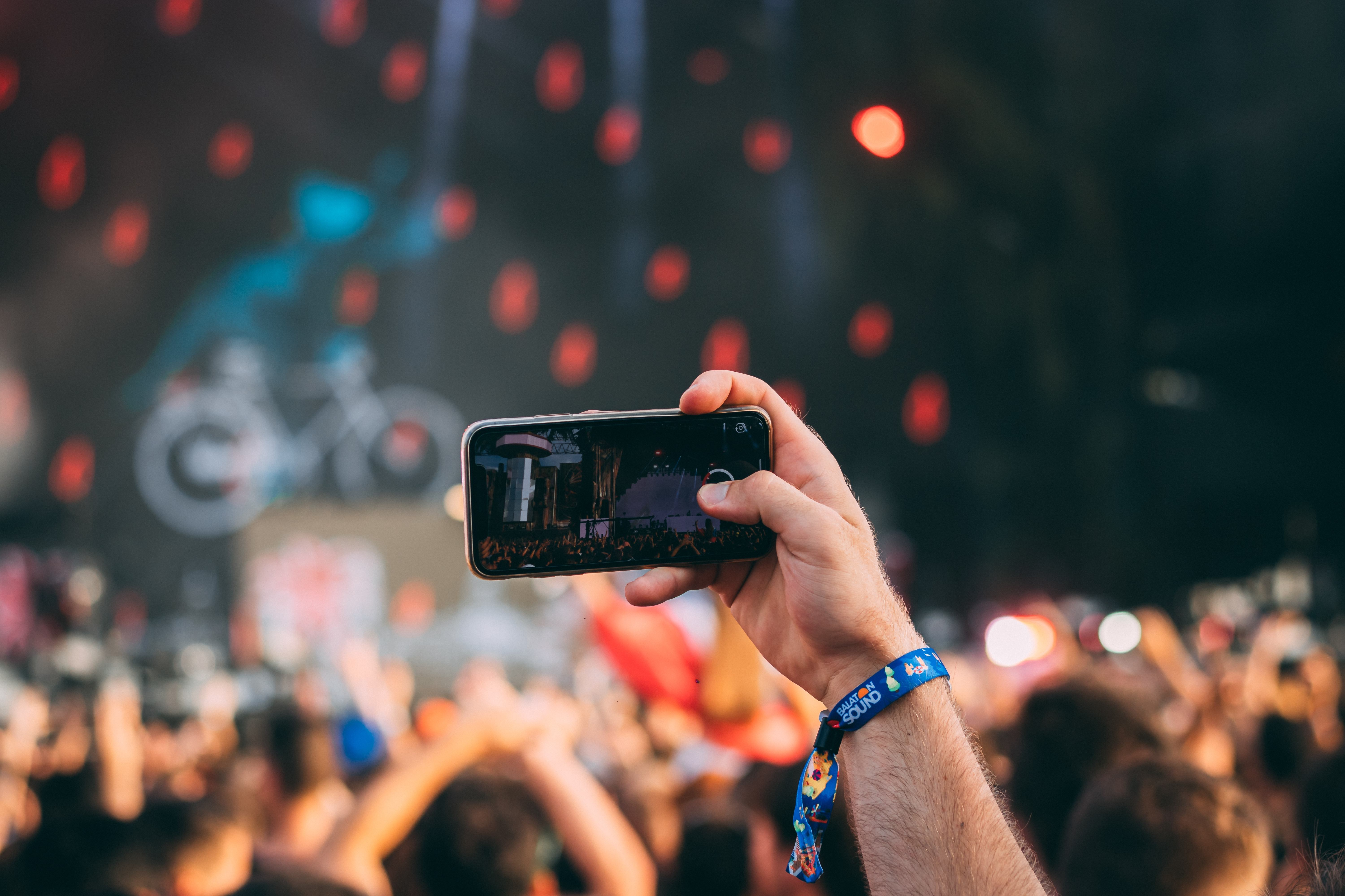 phone in man's hand at festival