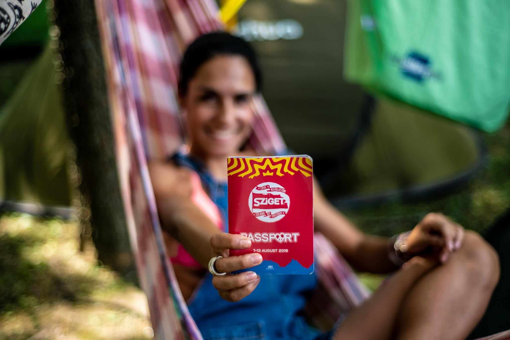 woman holding sziget passport