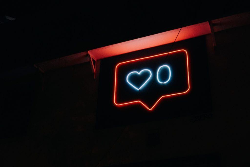 no social media likes in neon sign
