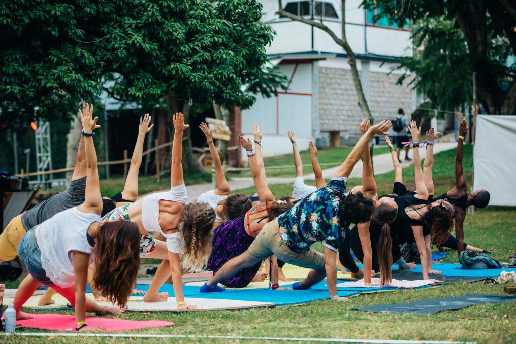 Shi FU Miz Music Festival festivalgoers doing yoga in the park