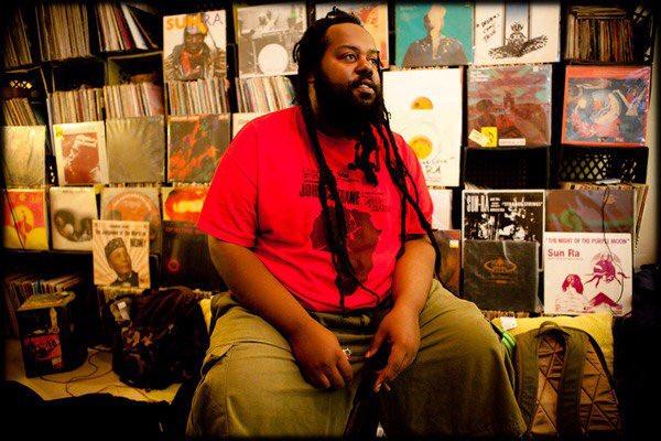 black artist ras g in his home studio