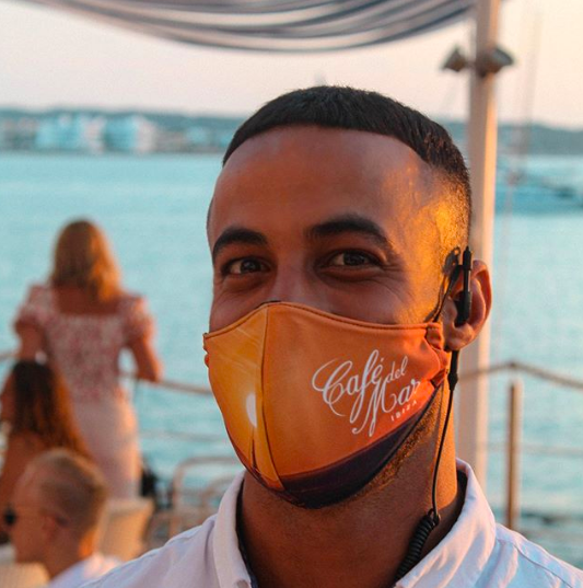 Staff at Cafe del Mar Ibiza wearing a mask